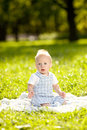 Cute little baby in summer park on the grass sweet baby outdoo outdoors smiling emotional kid a walk smile of a child Stock Image