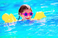 Cute little baby swiming in the pool swimming wearing funny sunglasses enjoying summer weekend aquapark holidays and vacation Stock Images