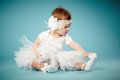 Cute little ballerina blue background Royalty Free Stock Images