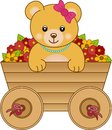 Cute little bear inside cart flowers Stock Photo