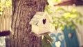 Cute little bird house capture of Stock Image