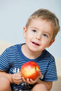 Cute little boy with apple Stock Photo