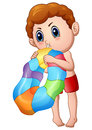 Cute Little Boy Blowing an inflatable ring