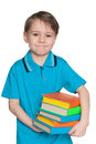 Cute little boy with books a closeup portrait of a on the white background Stock Photo