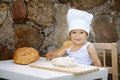 Cute little boy with chef hat cooking Stock Photography