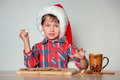 Cute little boy decorating the gingerbread cookies merry christmas Royalty Free Stock Photo
