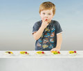 Cute little boy with delicious fruit cake Royalty Free Stock Photography