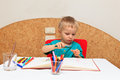 Cute little boy drawing Stock Photos