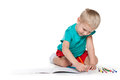 Cute little boy drawing on paper is sitting the floor and Royalty Free Stock Photography
