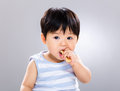 Cute little boy eating cookie Royalty Free Stock Photo
