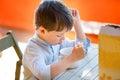 Cute little boy eating dairy breakfast Royalty Free Stock Photo