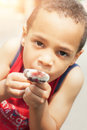 Cute little boy eating ice cream cone Royalty Free Stock Photo