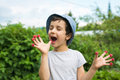 Cute little boy eats a berries from his fingers in a garden Royalty Free Stock Photo
