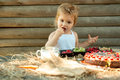 Cute little boy eats berries Royalty Free Stock Photo