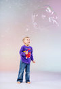 Cute little boy enjoying soap bubbles big Royalty Free Stock Photo