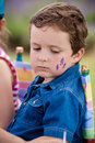 Cute little boy getting make up his face Royalty Free Stock Image