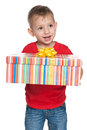 Cute little boy with a gift box against the white background Royalty Free Stock Images