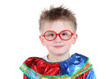 Cute little boy in glasses and clown costume Stock Image
