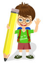 Cute little boy with glasses holding big yellow pencil Royalty Free Stock Photo