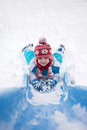 Cute little boy, going down a snowy slide Royalty Free Stock Photo