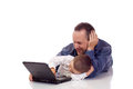 Cute little boy his father laying their stomach laptop Stock Images