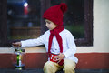 Cute little boy holding cup with tea waiting for santa impatiently Stock Image