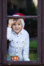 Cute little boy holding cup with tea waiting for santa impatiently Royalty Free Stock Images