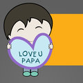 Cute little boy holding a heart shape note with text love you p papa on occasion of fathers day Stock Photography