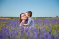 Cute little boy kissing his beautiful mother with her eyes closed with pleasure Royalty Free Stock Photo