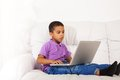 Cute little boy with laptop Royalty Free Stock Photo