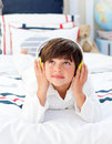 Cute little boy listening music with headphones on Royalty Free Stock Photography