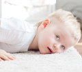 Cute little boy lying white carpet Royalty Free Stock Images