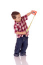 Cute little boy with a measuring tape Royalty Free Stock Image