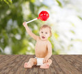 Cute little boy playing with big lollipop childhood and toys concept Stock Photos