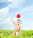 Cute little boy playing with big lollipop childhood and toys concept Royalty Free Stock Photography