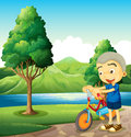 A cute little boy playing with his bike illustration of Royalty Free Stock Photo
