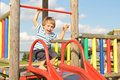 Cute little boy playing in the playground Royalty Free Stock Photo