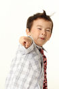 Cute little boy points at camera isolate on white background Royalty Free Stock Photo