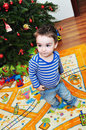 Cute little boy portrait a of a happy baby near christmas tree Stock Photography
