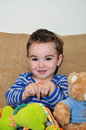 Cute little boy portrait a of a happy baby playing with toys Stock Image