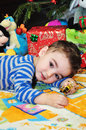 Cute little boy portrait a of a happy baby sitting on the floor playing with toys Stock Photography