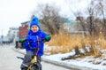 Cute little boy riding bike in winter, kids sport Royalty Free Stock Photo