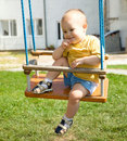 Cute little boy on swing Royalty Free Stock Images