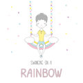Cute little boy swinging on a rainbow Royalty Free Stock Photo