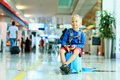 Cute little boy waiting in the airport Royalty Free Stock Photo