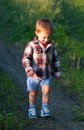 Cute little boy walking in the nature Royalty Free Stock Photos