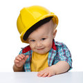 Cute little boy wearing oversized hard hat Royalty Free Stock Images