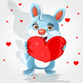 Cute little bunny holds a heart-pillow Stock Image