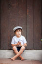 Cute little child, boy, holding big metal key and a book, willin Royalty Free Stock Photo