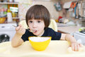 Cute little child eats soup at home Royalty Free Stock Photo